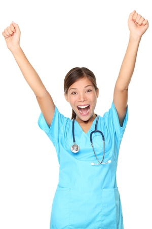nurses: Nurse excited. Happy cheerful woman nurse (or young doctor) with arms up. Isolated on white background. Young mixed-race Asian  Caucasian female medical professional.