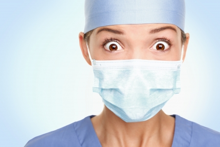 nurse cap: Doctor  surgeon shocked - funny. Woman closeup portrait of young doctor, surgeon or nurse surprised starring with big eyes wearing surgical mask. Asian  Caucasian female model.