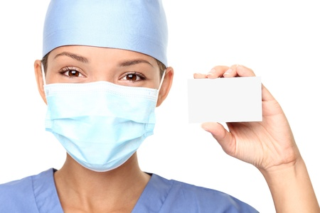 clinical staff: Nurse or young medical doctor woman showing business card isolated on white background. Closeup with copy space on blank empty sign.