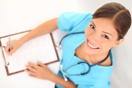 health care professional: Young medical doctor or woman nurse working. Asian  Caucasian female health care professional.