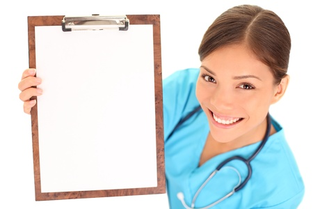 panoya: Medical sign. Young woman doctor  nurse showing empty blank clipboard sign with copy space for text. Mixed race asian caucasian female model isolated over white background.