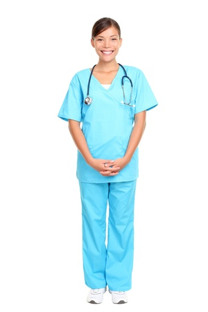 full length woman: Nurse standing isolated over white background. Mixed-race Asian  Caucasian woman nurse or young medical doctor smiling in full length.