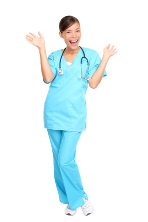 Nurse happy excited and joyful. Young woman nurse or doctor cheerful and joyful isolated in full length on white background.  photo
