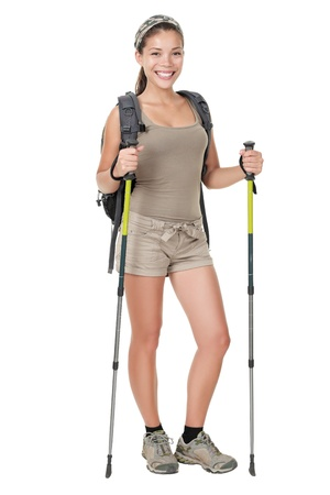 trekker: Hiking woman standing isolated. Female hiker with backpacking bag and hiking poles  walking sticks isolated on white background in full length.