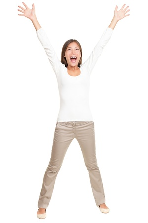 Happy cheerful young woman with arms up joyful. Young energetic and fresh Asian Caucasian model isolated on white background standing in full figure photo