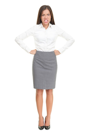 furious: Angry upset young business woman standing isolated in full length. Funny image of mixed race Asian Caucasian female model.
