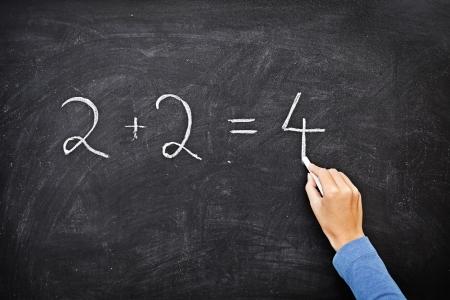 Math chalkboard / blackboard. Hand writing simple mathematical equation. Nice texture. Stock Photo - 8828804