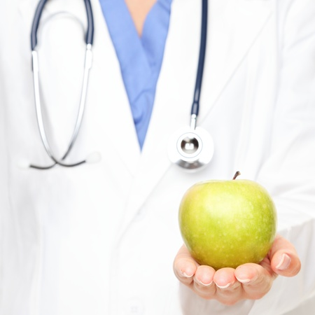 nutritionist: Health care. Doctor giving apple. An apple a day keeps the doctor away. Stock Photo