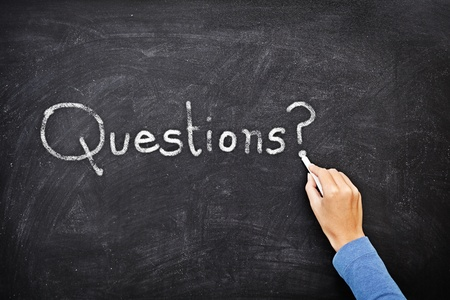 questions: Question written on chalkboard  blackboard. Hand writing with chalk ? great texture.