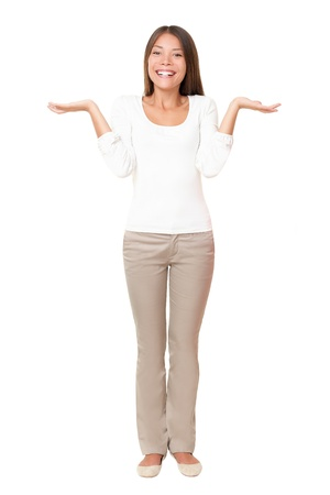 shrugging: Woman confused wondering shrugging with open palms. Beautiful asian lady standing isolated  white background. Multi ethnic Asian Caucasian girl in her 20s Stock Photo