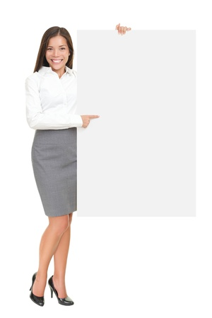 Businesswoman holding white blank empty billboard sign with copy space for text. Beautiful young mixed race Asian Caucasian woman isolated on white background in full length. photo