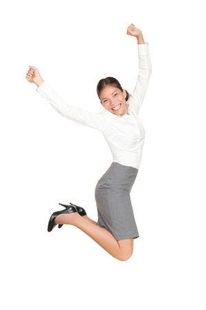 Success businesswoman jumping happy ecstatic celebrating with arms in the air. Fresh beautiful young casual mixed race Asian Caucasian business woman isolated on white background in full length. Stock Photo - 9096390