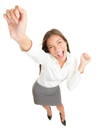 Success. Successful businesswoman cheering and dancing celebrating victory. Dynamic high angle view of young beautiful mixed race Asian Caucasian casual business woman. Isolated on white background in full body. Stock Photo - 9096412