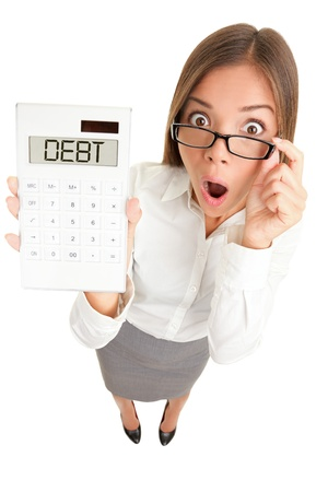 Debt and finance concept. Woman accountant showing calculator spelling DEBT. Funny image of Casual Asian Caucasian business woman isolated on white background. photo