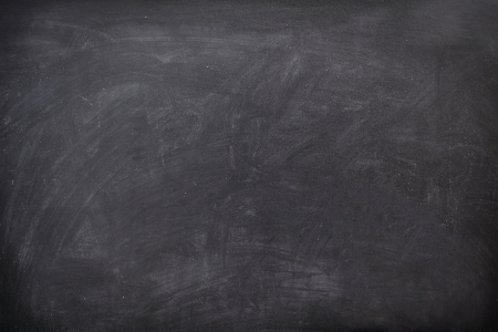 Blackboard  chalkboard texture. Empty blank black chalkboard with chalk traces photo