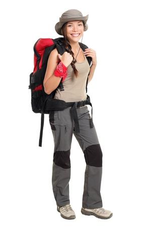 Mujer de excursionista aislada en permanente de fondo blanco de longitud completa. Hembra de Asia / caucásica de raza mixta hermosa en caminatas al aire libre de traje.