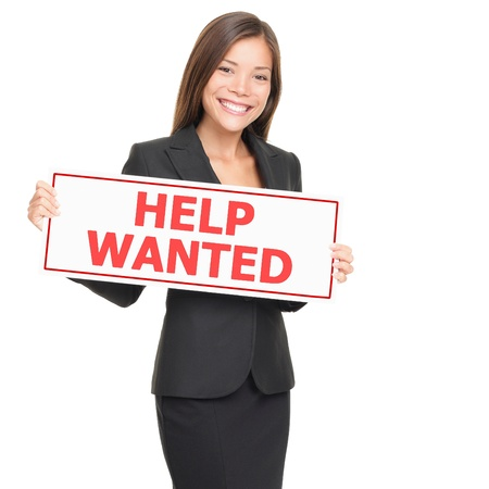 Woman holding help wanted sign. Businesswoman showing placard isolated on white background. Stock Photo - 9097576