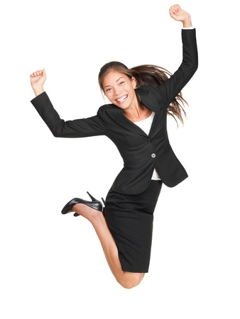 Jumping business woman. Celebrating successful businesswoman in suit jumping joyful isolated on white background in full length. Beautiful mixed race Asian Caucasian female model. photo