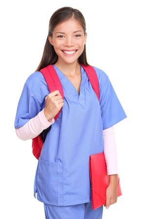 book bags: Medical student. Woman nurse or female medical student smiling with backpack and scrubs isolated on white background. Stock Photo