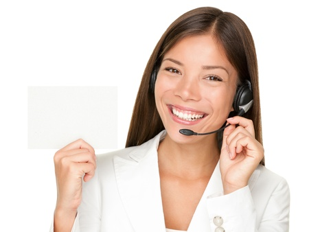 customer service: Headset. Customer service operator woman from call center smiling with headset showing blank empty sign card for copy space. Beautiful mixed race Asian Caucasian woman isolated on white background.