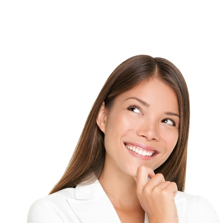 thinking woman isolated on white background looking up smiling having an idea. Beautiful young mixed race woman in business suit photo