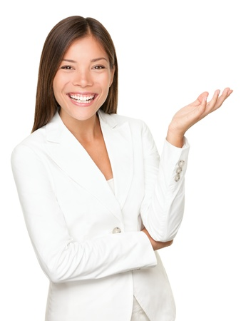 explain: woman gesturing  showing. Businesswoman in white suit smiling looking at camera explaining with gesture. Beautful young mixed race woman professional isolated on white background.