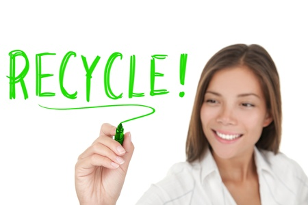 Recycling. Woman writing recycle with green marker isolated on white background. Asian Caucasian businesswoman. photo
