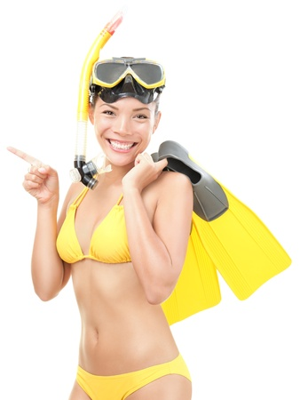 flippers: woman with goggles, flippers and snorkel pointing. Snorkeling, swimming, vacation concept isolated on white background. Chinese Asian  Caucasian female model