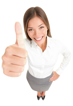 vysoký úhel pohledu: Thumbs up success woman happy smiling. High angle view of young successful mixed race Asian Caucasian businesswoman isolated in full body on white background.