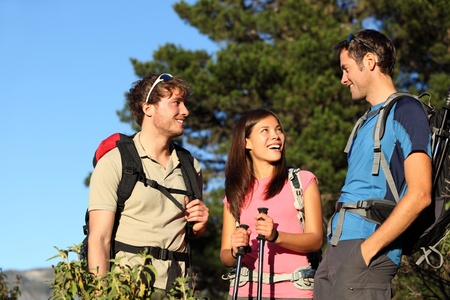 Hikers. Group of friends hiking and relaxing during hike in forest. Outdoors people enjoying and having fun on Tenerife, Canary Islands, Spain Stock Photo - 9493535