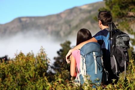 backpackers: Couple hiking looking at view during hike in forest on Tenerife, Canary Islands, Spain