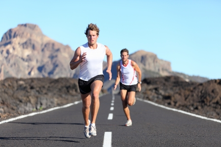 Sport running. Male Runners on road in endurance run outdoors in beautiful landscape Stock Photo - 9577472