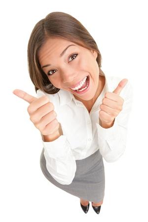 businesswoman suit: Felices pulgares arriba mujer de �xito aislado sobre fondo blanco. Imagen de vista superior de alto �ngulo de alegre alegre asi�tica cauc�sica joven sonriente de longitud completa.