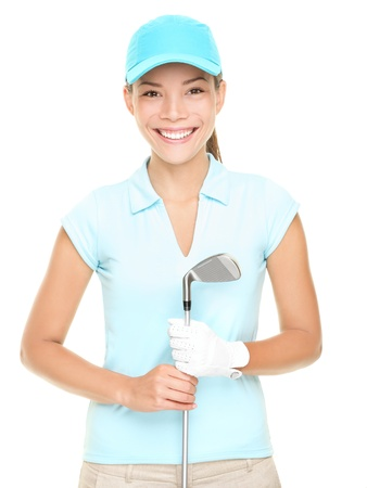 Woman golf player smiling holding golf club isolated on white background. Young mixed race Asian Caucasian female golf player photo