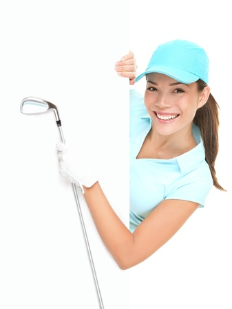 Golf sign - female golf player showing white paper sign holding golf club. Beautiful smiling Asian Caucasian woman isolated on white background. photo