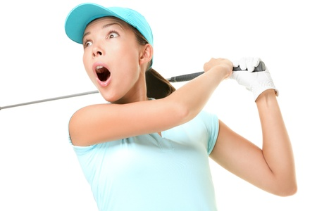 Woman playing golf surprised over golf swing. Female golf player with swinging golf club isolated on white background. Asian Caucasian woman. photo