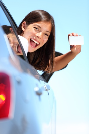 happy woman in car enjoying her freedom on vacation summer road trip. Beautiful young multiracial model  photo