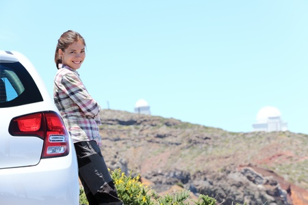 Car woman road trip on La Palma, Canary Islands. Observatory at Roque de los Muchachos in background. photo