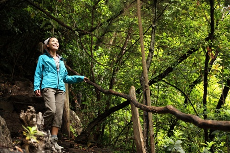 tourist destination: Hiking La Palma, Canary Islands. Woman hiker enjoying Los Tilos Laurel Rain Forest on La Palma