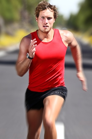 athlete running: Man running fast. Runner with motion blur for speed effect. Caucasian male athlete doing exercise outdoor.