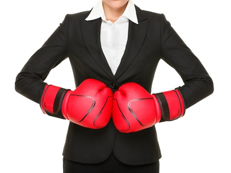 girl punch: Competition ready - business concept. Businesswoman punching red boxing gloves together isolated on white background. Stock Photo