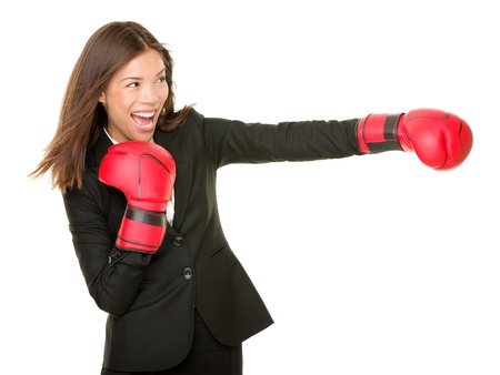 business woman boxing concept. Businesswoman in suit punching with red boxing gloves isolated on white background. Stock Photo - 10132841