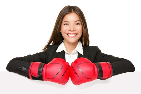 business woman sign - boxing gloves. Businesswoman boxer in suit showing blank empty paper poster billboard sign smiling happy at camera. Beautiful Asian  Caucasian young female professional isolated on white photo