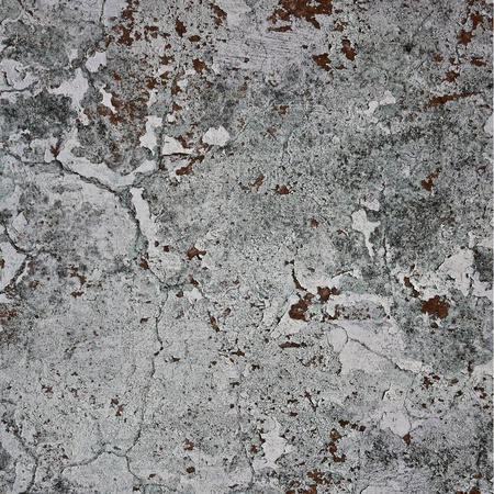 cracking: Grunge wall texture grey background. Paint cracking off dark wall with rust underneath. Stock Photo