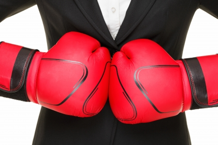 business concept - boxing gloves and suit. Businesswoman punching red boxing gloves together isolated on white background. Stock Photo - 10283064