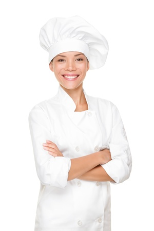 Chef, cook or baker woman. Happy proud portrait of female in chef uniform and chef hat isolated on white background. Asian Caucasian woman model. photo