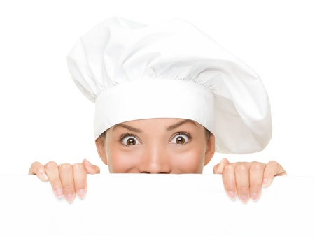 Chef Sign. Woman cook / baker looking over paper sign billboard. Surprised and funny expression on young Asian / Caucasian woman isolated on white background. Stock Photo - 10283041