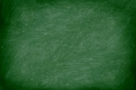 Chalkboard  blackboard green. Empty blank with copy space for chalk text. Used feel with chalk traces and great texture. From Photo. Stock Photo