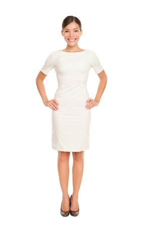 Full body woman portrait standing in business dress suit in full length isolated on white background. Beautiful young mixed race chinese asian  white caucasian female businesswoman in her mid twenties.