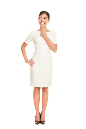 Thinking business woman standing in full body isolated on white background contemplating looking up to the side smiling happy. Beautiful Asian  Caucasian businessowman in dress suit.